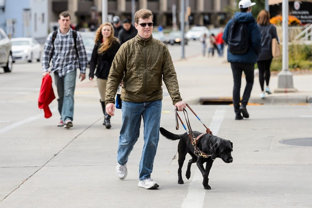 Photo: Drew Hasley and guide dog Shade