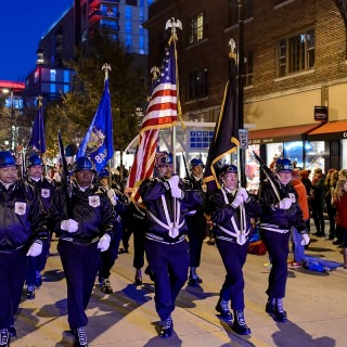 Members of the Wisconsin Veterans of Foreign Wars color guard march down State Street.