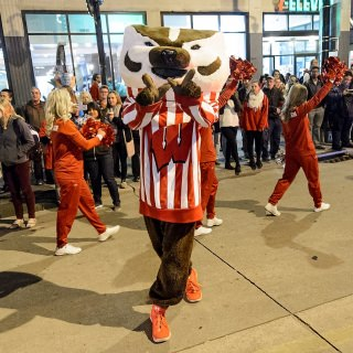 Bucky Badger waves to the thousands of spectators lining State Street.
