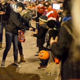 For younger fans, the parade is a chance to restock Halloween candy.