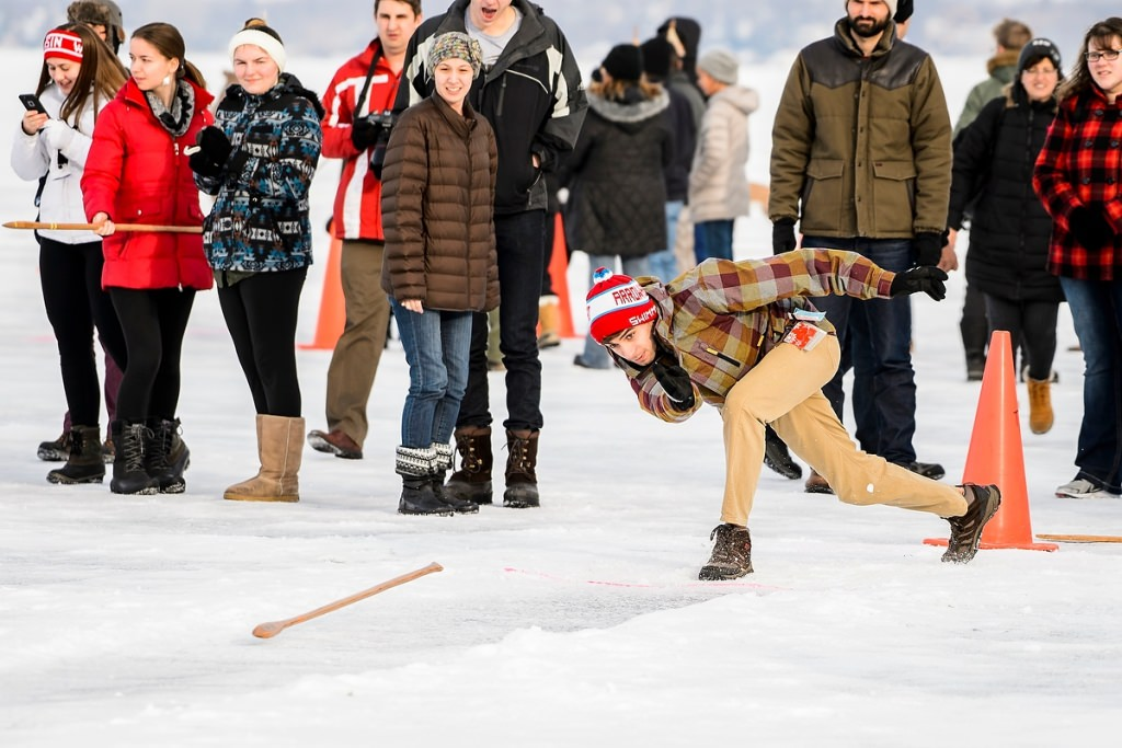 Photo: Participant throwing snow snake