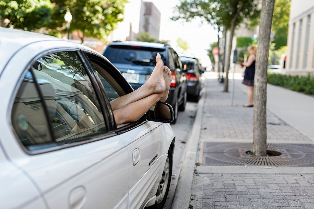 Photo: Bare feet dangling from car window
