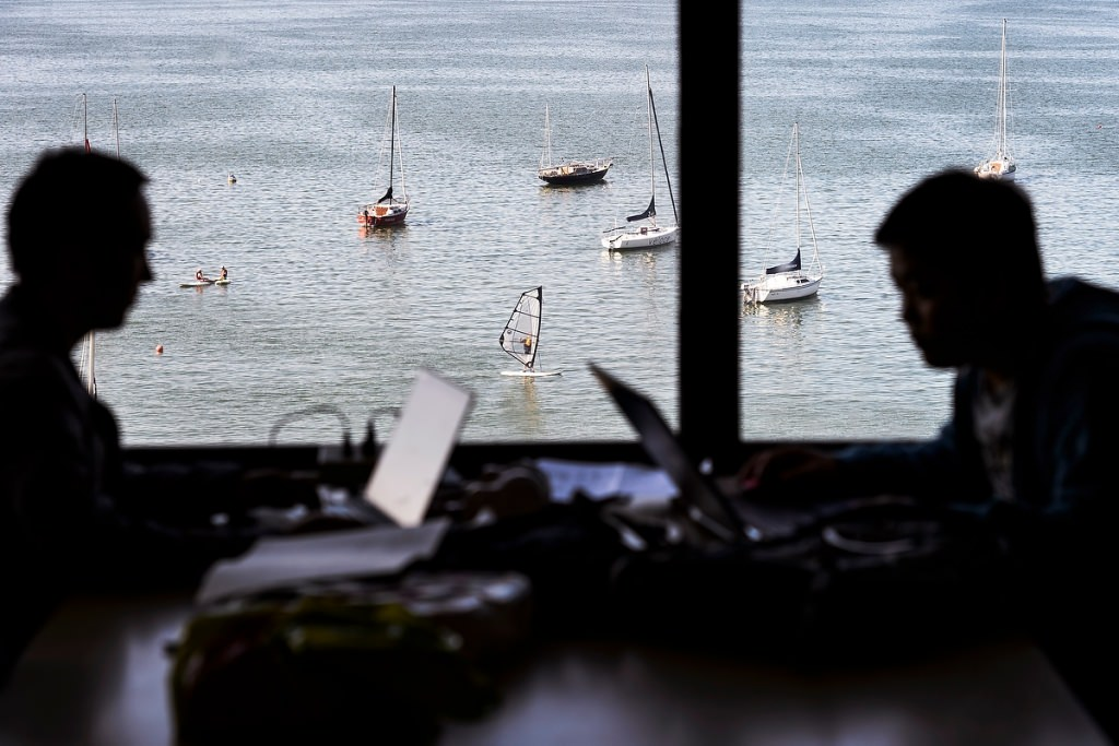 Photo: Students near window showing lake