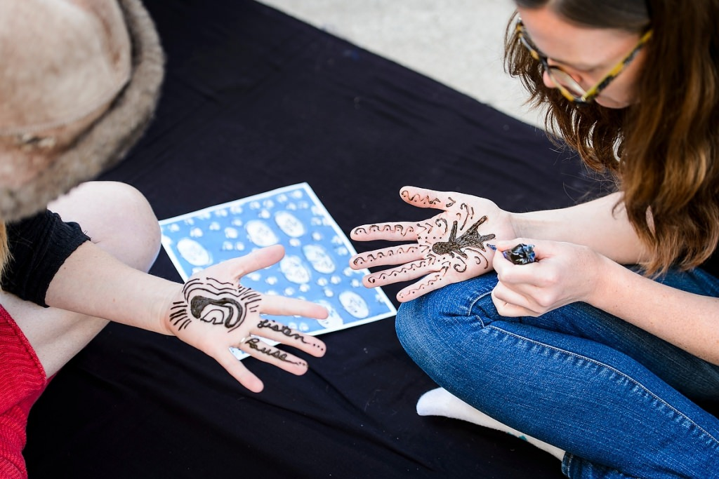 Photo: Students with henna designs on hands