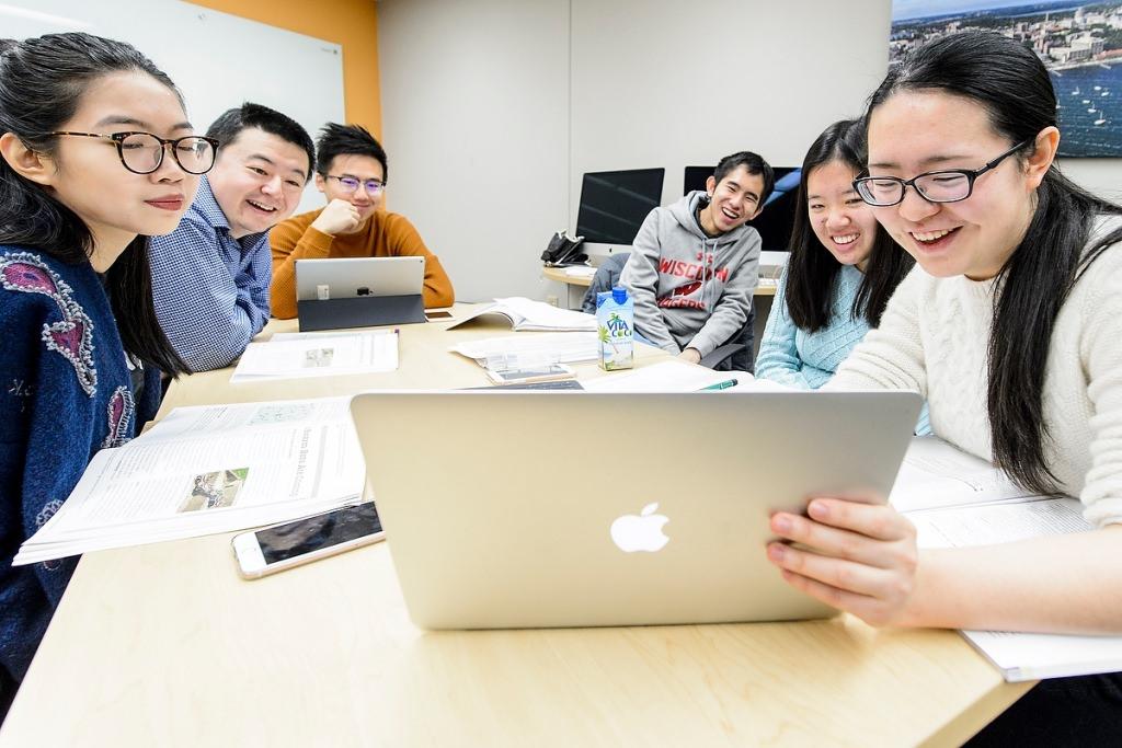 Photo: International students looking at computer