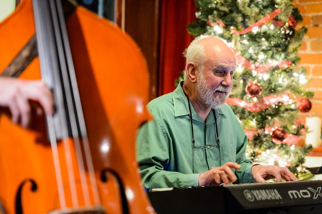 Fred Blattner, an emeritus professor of genetics and an entrepreneur, plays electric piano during the Sunday Jazz Jam at The Rigby Bar and Grill in downtown Madison on Dec. 4.