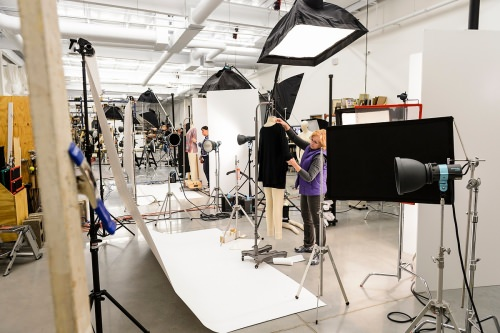 Staff photograph merchandise at an in-house photography studio at Colony Brands, for inclusion in one of the company's catalogs.