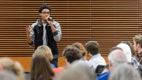 UW student Deshawn McKinney speaks during a public roundtable discussion in 2014.
