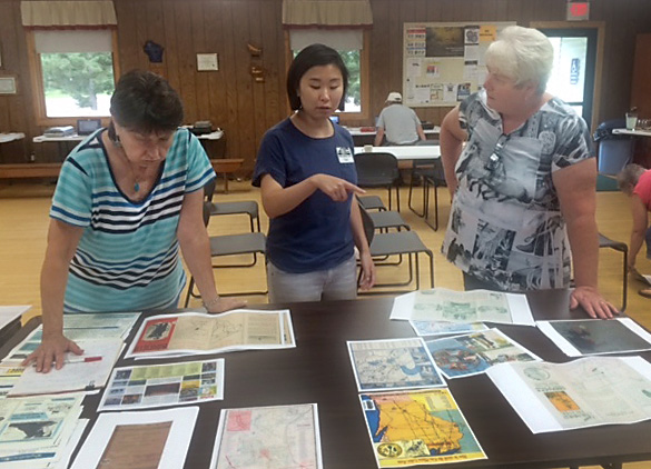 At the Barnes Town Hall. UW–Madison graduate student Catherine Hannula, center, speaks with Tam Larson, of the Barnes Area Historical Association, and a local attendee.