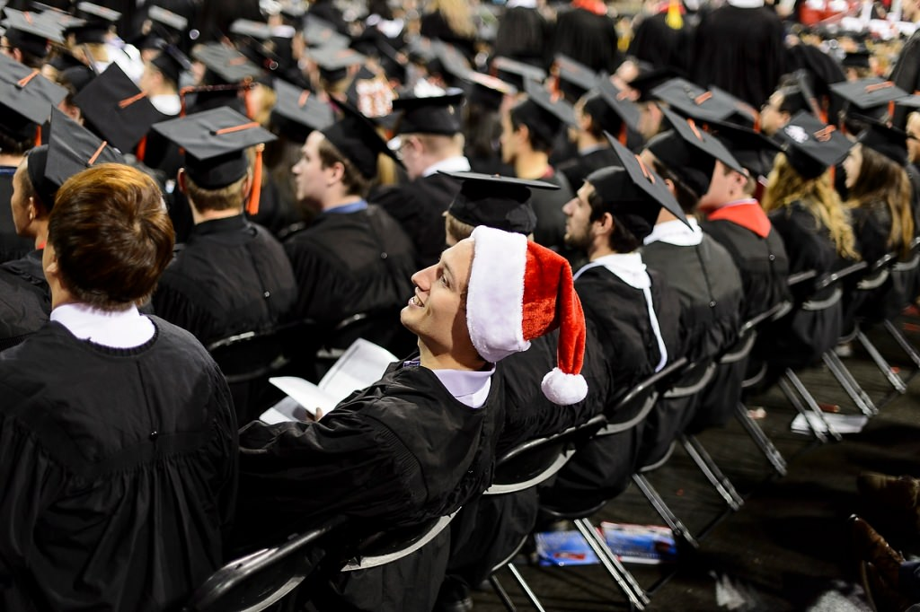 A graduate wearing a Santa hat adds a pop of color to the winter commencement in 2015. This year's winter commencement is Dec. 18.