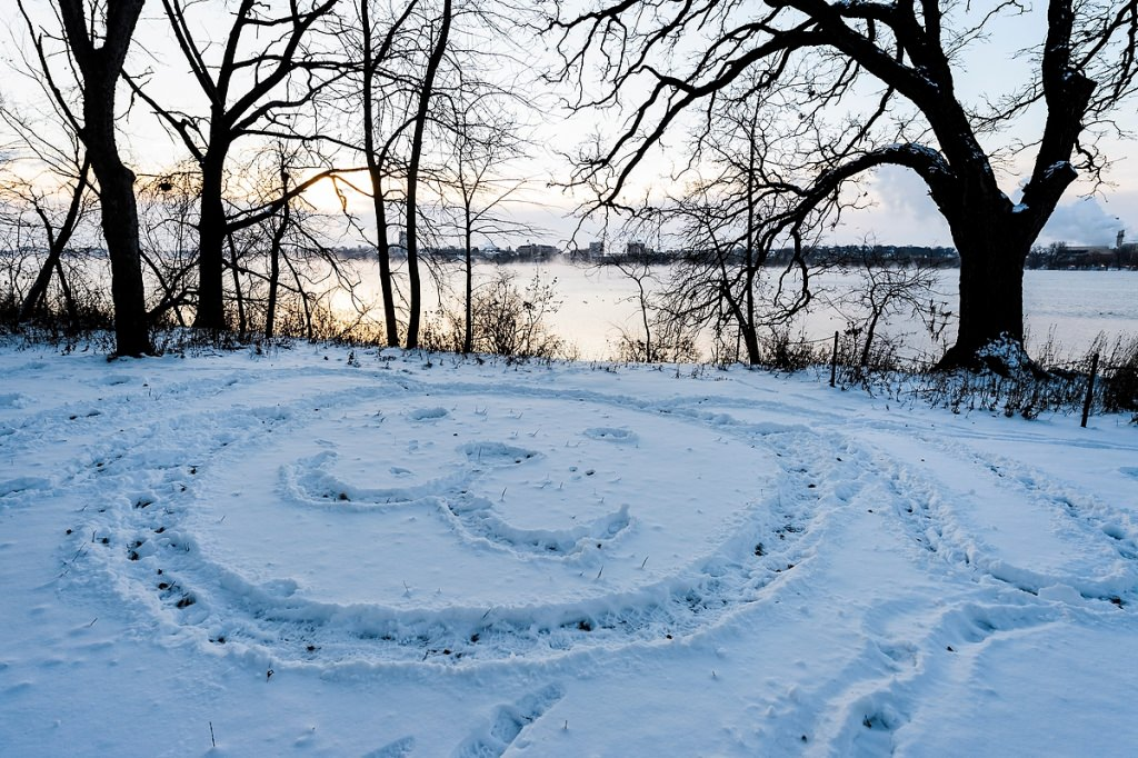 A message in the snow greets early risers along the Picnic Point shoreline on a December morning.