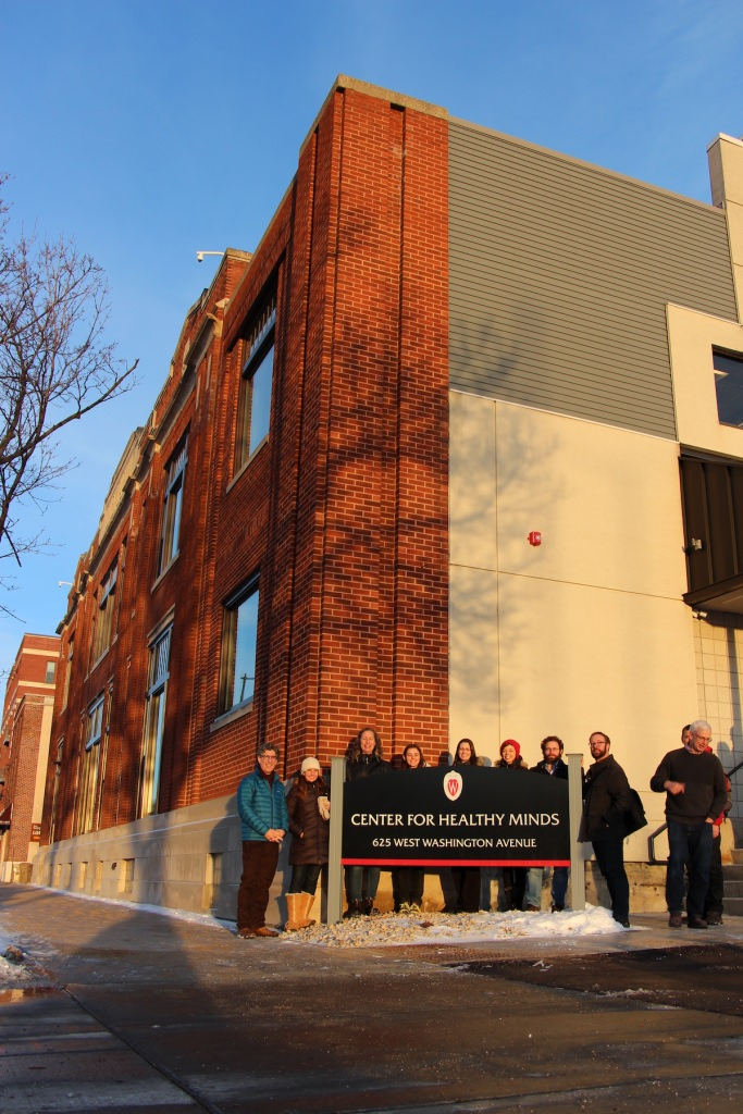 Staff members of the Center for Healthy Minds outside their new office at the renovated Kennedy Dairy Building, 625 W. Washington Ave.