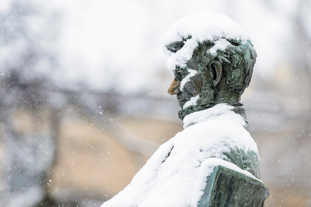 The Abraham Lincoln statue gets a chilly coat of snow.