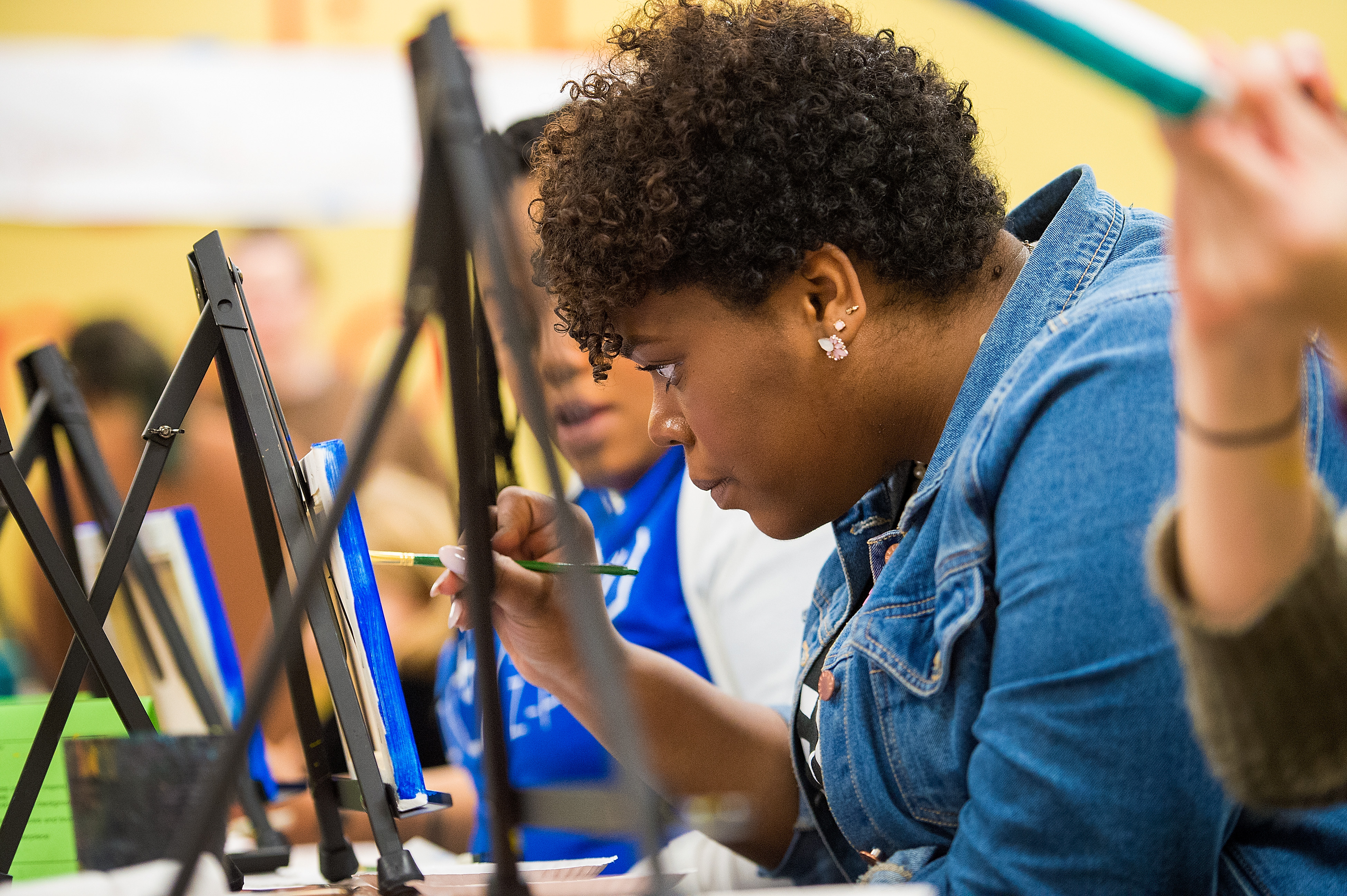 LeAnna Level takes part in an art project at Wheelhouse Studios in Memorial Union.