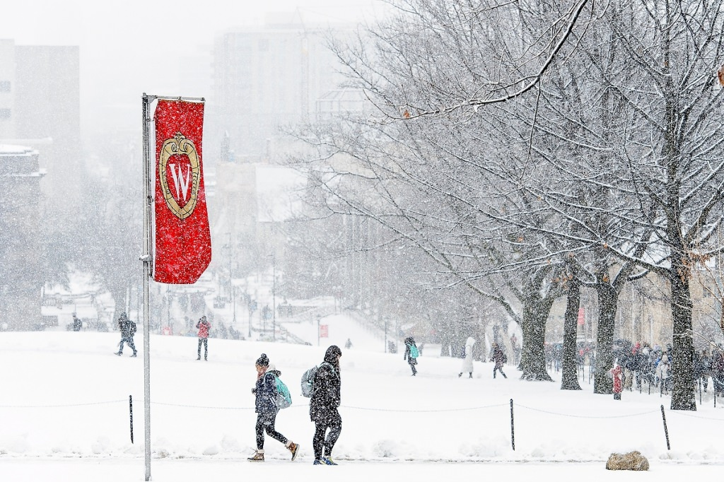 As a fresh coat of snow falls, students make their way to class.