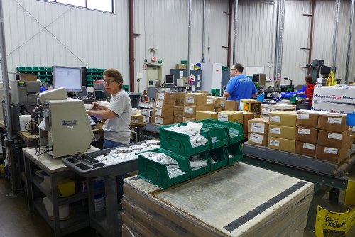 Workers process parts orders for delivery to Endries customers.