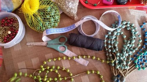 The women in Ecuador use local beads, string and other materials to make their necklaces that are sold in Madison.