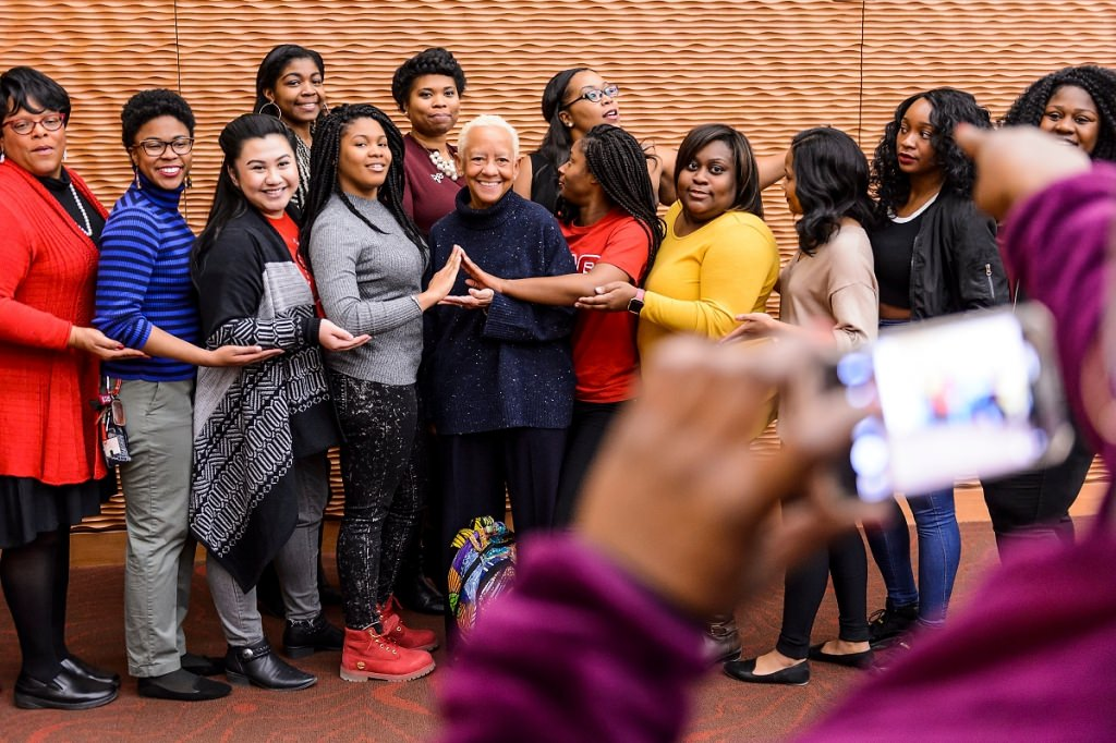 Giovanni poses with sisters of Delta Sigma Theta Sorority during a meet-and-greet session with UW-Madison students and guests.