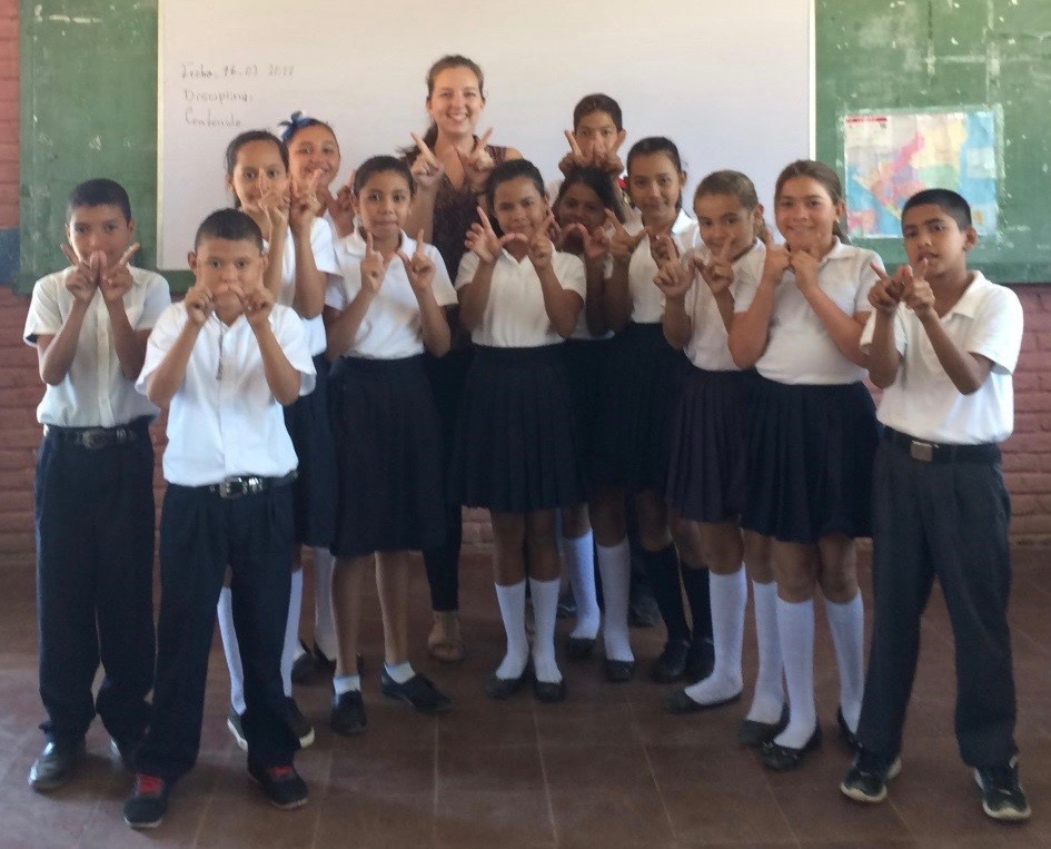 As an environment volunteer for the Peace Corps in Nicaragua, Laura Linde, center rear, teaches science in elementary schools, facilitates gender-focused camps, and is involved in Peace Corps Nicaragua's gender and development committee.