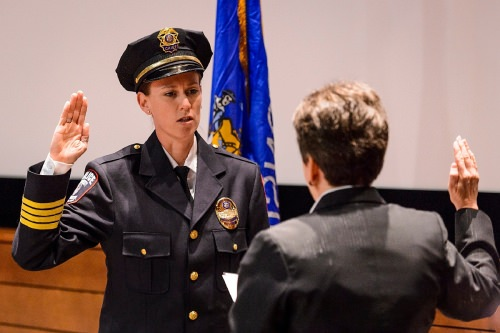 At left, UW Police Department Chief Kristen Roman pledges the Oath of Office to retired Police Chief Susan Riseling, right, during Roman's formal swearing-in ceremony at Union South's Marquee Cinema at the University of Wisconsin–Madison on Feb. 1, 2017. (Photo by Jeff Miller/UW-Madison)