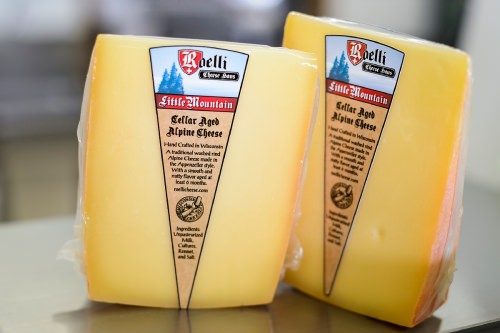 Selling at more than $22.00 per pound, packages of Little Mountain cheese are pictured at Roelli Cheese Haus.