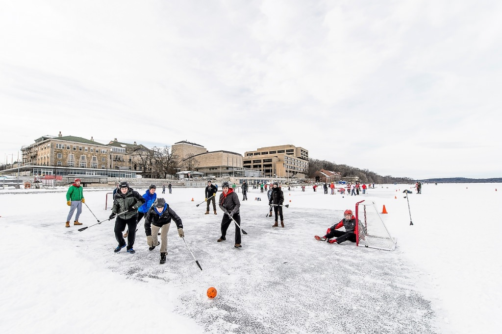 Dozens of students take part in a broomball tournament hosted by Rec Sports.