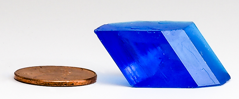 Photo: Bluestone crystal next to a penny for reference