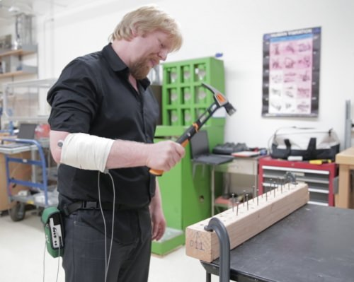 Volunteers pounded nails with Fiskars' new IsoCore hammer while researchers — hoping to determine how the hammer helped prevent overuse injuries — measured muscle activity in their forearms.