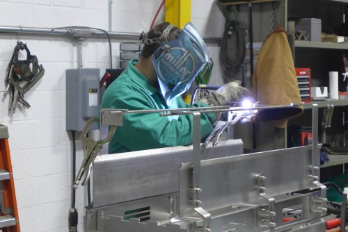 Photo: Worker welding a sub-assembly