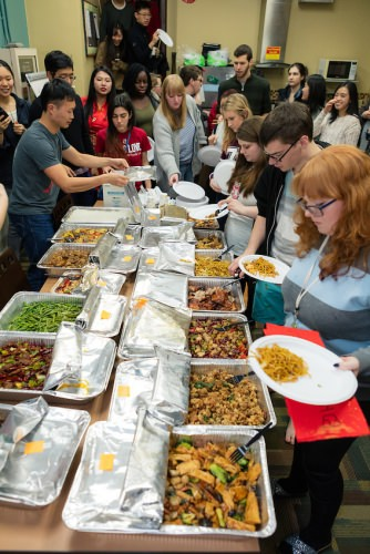 ILC students feast during a traditional Lunar New Year celebration.