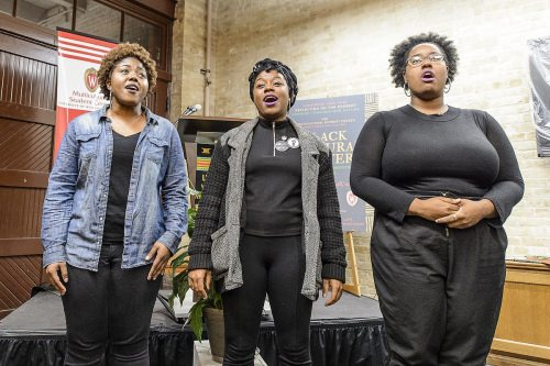 Nikeya Bramlett, Deja Mason and Bobbie Briggs, members of the University Gospel Choir, perform before a crowd of over 100 people during a dedication and libation ceremony for the new Black Cultural Center.