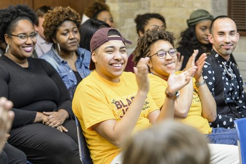 Audience members applaud during a dedication and libation ceremony for the new Black Cultural Center.
