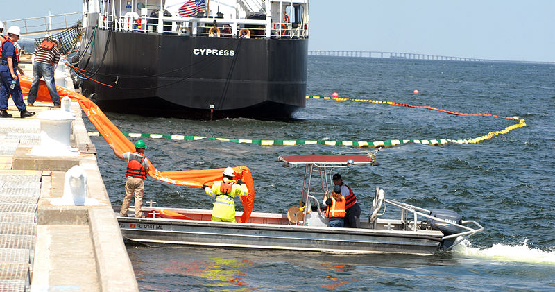 Photo: Contract employees with BP America load an oil containment boom onto a work boat to assist in oil recovery efforts from the Deepwater Horizon oil spill in the Gulf of Mexico.