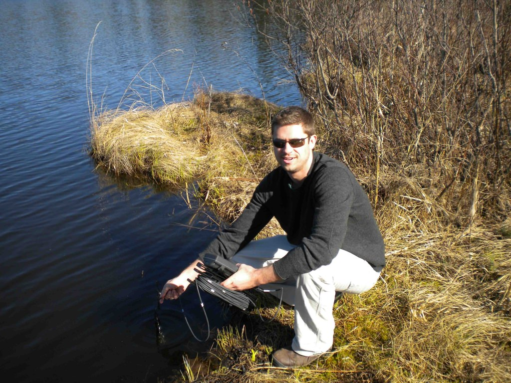 Ryan Batt takes a reading of oxygen levels in a Center for Limnology study lake in Northern Wisconsin.