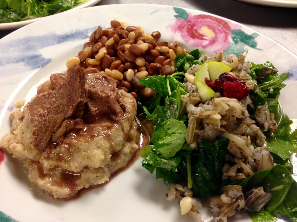 Braised buffalo over polenta, tepiary tri color beans, and wild rice salad is an example of the type of food attendees can expect at the Food Sovereignty Symposium and Festival.
