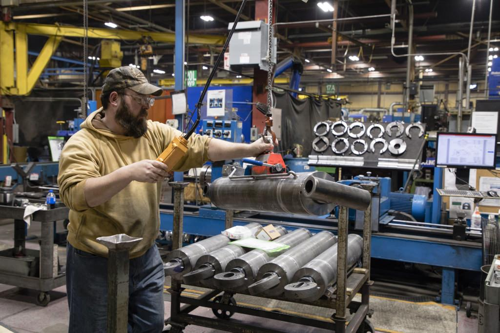 Jessie Smith puts the finishing touches on some hydraulic cylinders at JARP Industries in Wausau.