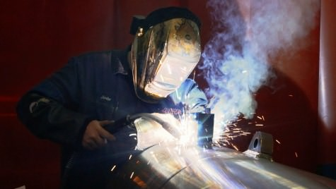Jim Krueger welds at JARP Industries in Wausau. A UW-Madison course helped the company become more efficient.