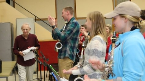 Varsity Band members applaud director Mike Leckrone as he returns to work March 15 following double bypass surgery.