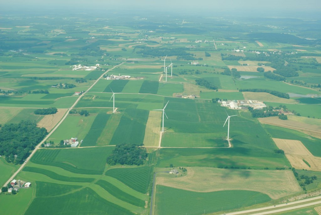Photo: Aerial view of farm fields and wind turbines