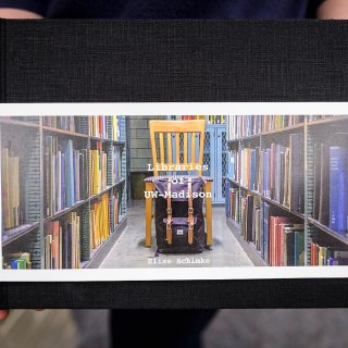 Undergraduate student Elise Schimke presents the cover of her photo book,