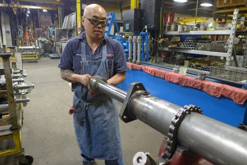 Tommy Yang works on a hydraulic cylinder at JARP Industries in Wausau.