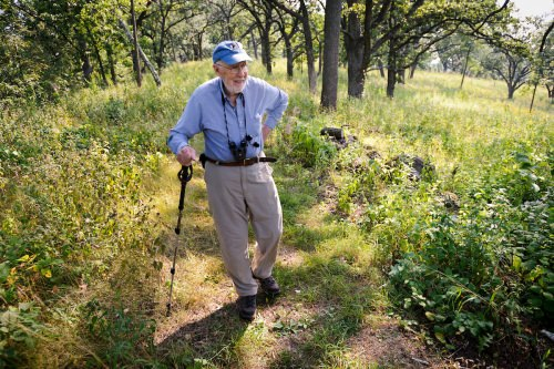 In 2013, Tom Brock walks in 140 acres of restored prairie, oak savannah and woodlands that he and his wife established as the Pleasant Valley Conservancy in Black Earth, Wisconsin.