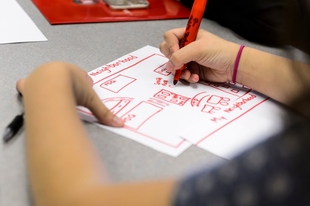 Photo: Closeup of neighborhood picture being drawn by a student