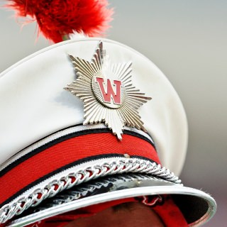 "Wendy Margolis, UW-Madison's Marching Band administrative coordinator, is known for her work ethic, initiative, creativity and ability to anticipate and solve problems. Since starting in the position in 2013, Margolis has made a positive impact on her department. She has instituted more structured schedules for student staff, better methods of assigning workloads, and a greater sense of pride in the staff's accomplishments. To maintain that positive direction, she created a new hiring process for band staff, with more reliable position descriptions, detailed application forms and a more professional interview process overall. Margolis has also developed new procedures for effectively contacting, recruiting and auditioning new students. Additionally, through her initiatives the band department has increased its contact with donors and would-be donors in the ""Spirit of Wisconsin Endowment Campaign."" Margolis reorganized and streamlined the procedure for High School Band Day, in which 3,000 Wisconsin high school students come to campus. (Margolis was not available to be photographed)"