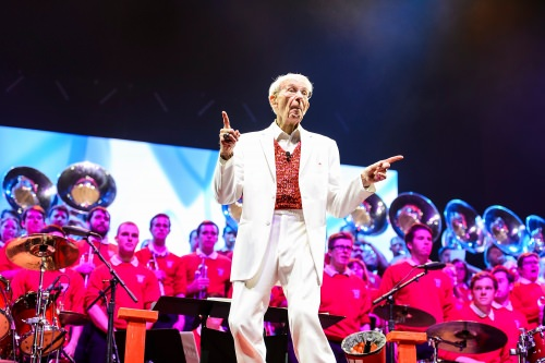 """Band director Mike Leckrone, 80 and now in his 47th year at UW–Madison, directs the 43rd annual UW Varsity Band Spring Concert at the Kohl Center at the University of Wisconsin–Madison on April 20, 2017. This year's concert, entitled """"Nobody Does It Better: 20 Years at the Kohl,"""" comes after Leckrone's return to campus following recovery from a medical procedure this past winter. (Photo by Jeff Miller/UW-Madison)"""