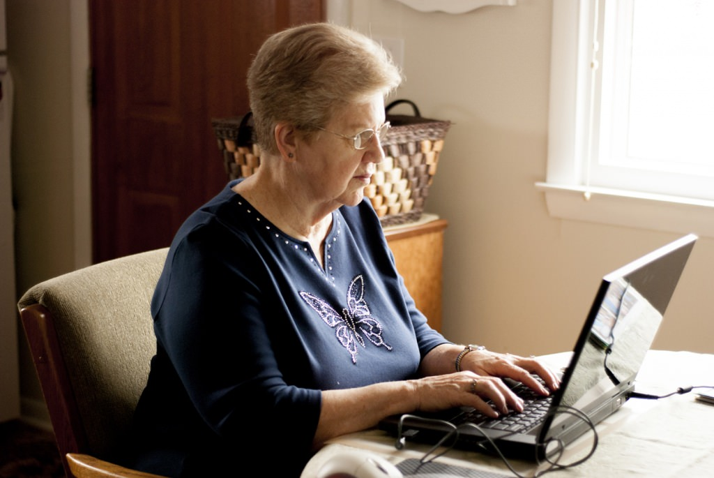 Photo: Elderly woman at laptop computer