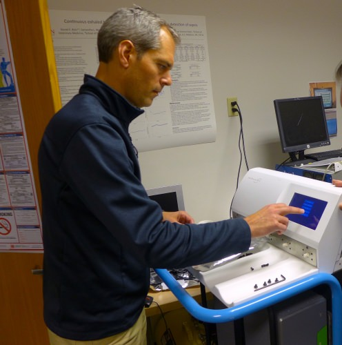 Isomark CEO Joe Kremer demonstrates the steps needed to measure carbon isotopes in a specimen container in Isomark's instrument. Isomark is a spinoff from UW–Madison.