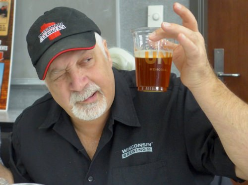 Kirby Nelson, brewmaster at Wisconsin Brewing, Verona Wisconsin, sizes up one of the six beers being judged at Babcock Hall.