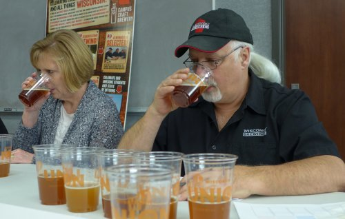 Kirby Nelson and Suzanne Thompson at work judging beers during the Campus Craft Brewery competition. Thompson, a Food Science graduate, manages quality systems and regulatory compliance at MillerCoors in Milwaukee, and oversees the corporate analytical and sensory labs.