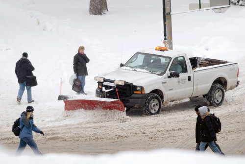 A Physical Plant truck plows snow and salts a slippery pedestrian walkway along Linden Drive in 2007. Such salt is raising the salt levels of freshwater lakes.